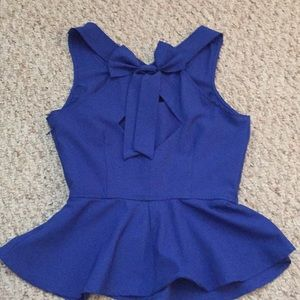 Royal blue peplum top with back bow